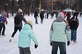 People On Skating Rink In Park