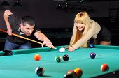 image of snooker  - Young couple playing snooker in a billiard club - JPG
