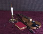 book, candle and violin