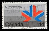 CANADA - CIRCA 1978: A stamp printed in Canada shows a symbol of XI Commonwealth Games with the same inscriptions and name of series, circa 1978