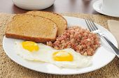 stock photo of hash  - hearty breakfast of corned beef hash and eggs with toast - JPG
