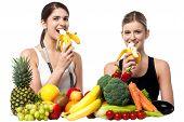 Young Smiling Girls Eating Banana