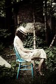 elegant melancholic  woman sit in garden