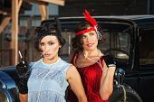 foto of gangster necklace  - 1920s flapper girls with cigarette near vintage automobile - JPG