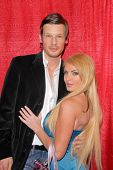 Yuri Bradac and Taylor Wane at the Celebrity Karaoke and US Troop Care Package Party, Locals Sports Bar & Grill, Los Angeles, CA. 04-06-10