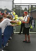 Two times Grand Slam champion Victoria Azarenka signing autographs after practice for US Open 2013