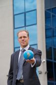 Businessman With Globe In Hand