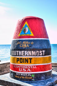 pic of mile  - Vibrant HDR image of the iconic Key West southernmost point marker in the Continental USA indicating 90 miles to Cuba - JPG