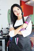 Beautiful woman hairdresser in beauty salon