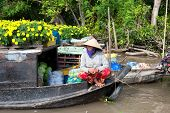 CAN THO,VIETNAM - 23 JAN, 2014: Unidentified woman on floating market in Mekong river delta. Cai Ran