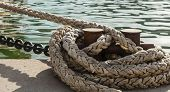 Mooring bollard with nautical rope