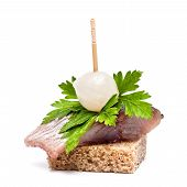 stock photo of canapes  - Canapes herring sandwich with black bread on white background - JPG