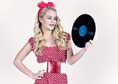 stock photo of lp  - Retro girl holding vinyl LP - JPG