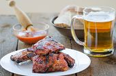 picture of marinade  - Spareribs on grill with hot marinade czech beer and bread - JPG