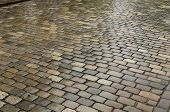 picture of cobblestone  - A wet cobblestone street after the rain - JPG