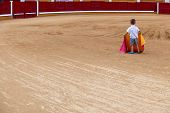 stock photo of bullfighting  - Unidentified child on arena pretending performs a bullfight Badajoz Spain - JPG
