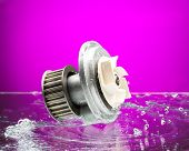 Auto Parts, Engine Cooling Pump In Spurts Of Water On Purple Background.