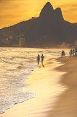 image of ipanema  - Warm Sunset on Ipanema Beach with People Rio de Janeiro Brazil - JPG