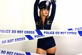 picture of strip tease  - beautiful young women dancing and posing dressed as a sexy police officer - JPG