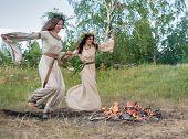 Attractive women jumping through fire