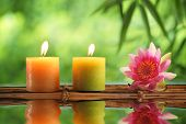 stock photo of lily  - Spa still life with burning candles and water lily - JPG