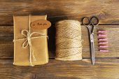 pic of french culture  - Natural style handcrafted gift box on wooden background - JPG