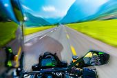 Slow motion of motorbike riding on the mountainous highway, extreme sport, touring along Alps, summer adventure, speed concept