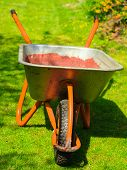 Gardening. Garden Wheelbarrow With Sand Soil.