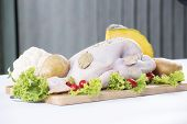 Raw Whole Chicken On The Board