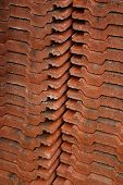 image of red roof tile  - Tall stacks of new red roof tiles - JPG