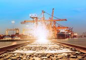 picture of railroad yard  - ship on port perspective of railroads track use for transportation background - JPG