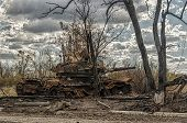 Overcast sky, burnt tank