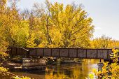 foto of trestle bridge  - Railroad bridge crossing river in the Fall - JPG