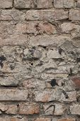 Old Brick And Mortar Wall In Decay