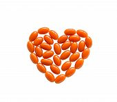 stock photo of enzyme  - Coenzyme Q10 heart shape isolated on white - JPG