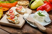 stock photo of curd  - Healthy baguette spread curd cheese with vegetable and herbs variations of peppers - JPG