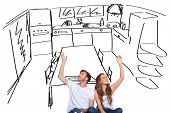 Happy young couple with hands raised against kitchen sketch