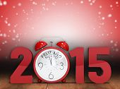 2015 with alarm clock against shimmering light design over boards