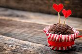 picture of wood pieces  - chocolate muffins on dark wood background for Valentine - JPG