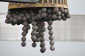 Magnet holds grinding balls when loading