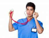 Male Doctor use of stethoscope