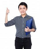 Business man with clipboard and thumb up