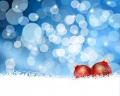 Gold Christmas background with baubles nestled in snow