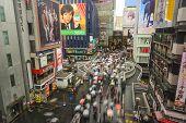 OSAKA, JAPAN - APRIL 30, 2014: Crowds walk across the Dotonbori bridge in Osaka during the Golden Week holiday.
