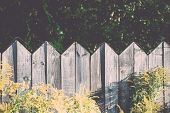 Old Wooden Fence With Barbed Wire On Top. Vintage.