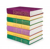 Stack Of Colorful Vintage Book With Gold Ornament On A White Background