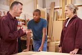 picture of carpentry  - Carpenter Talking To Apprentices In Carpentry Workshop - JPG