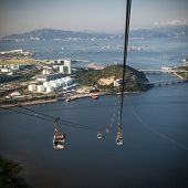 stock photo of lantau island  - Cable Car way to mountains above the river  - JPG