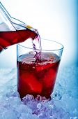 stock photo of pitcher  - closeup of a glass with typical spanish sangria being filled from a pitcher - JPG