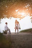 image of dirt road  - Happy attractive couple outdoors on dirt road under avenue of trees - JPG